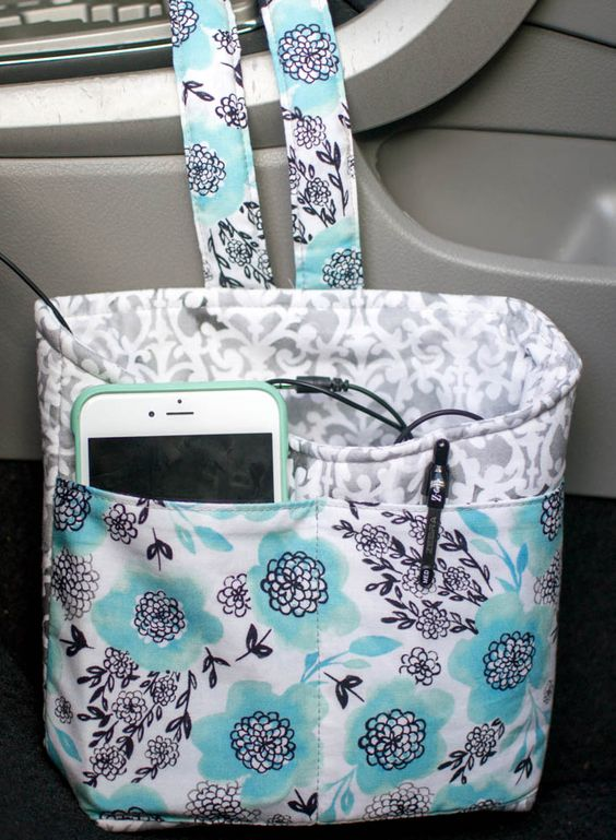 Keep your phone and other bits and pieces safe in the car with this CUTE bag!