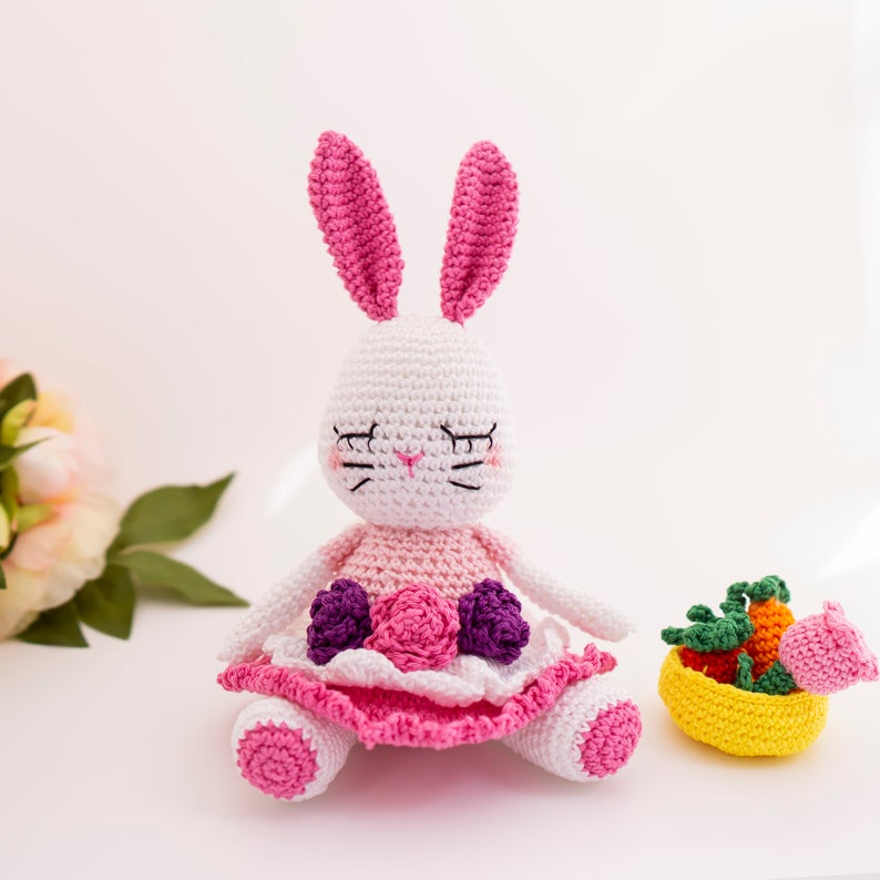 How cute is this Easter Bunny doll? She'll make the perfect gift for a child this Easter and you can crochet her by following the amigurumi pattern