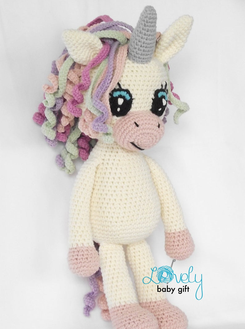 Don't miss this easy to follow crochet pattern to make a sweet unicorn toy any child will love to play with