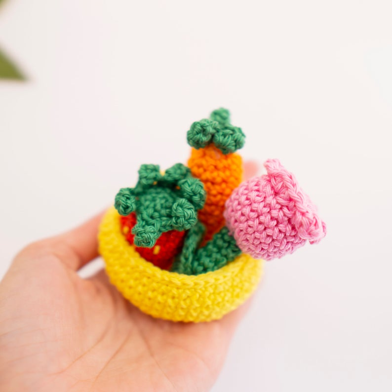 As well as the bunny you can also crochet a carrot, strawberry and a flower for her to carry in her basket.