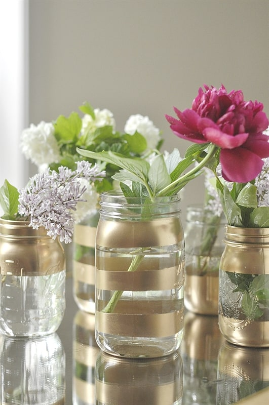 Here's an elegant hostess gift idea, these vases look wonderful and you have to look twice to realise that they're mason jars.