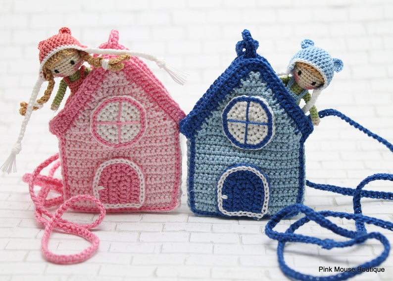 These adorable crochet dolls also come with a house - that's a necklace making it the perfect toy to travel with!