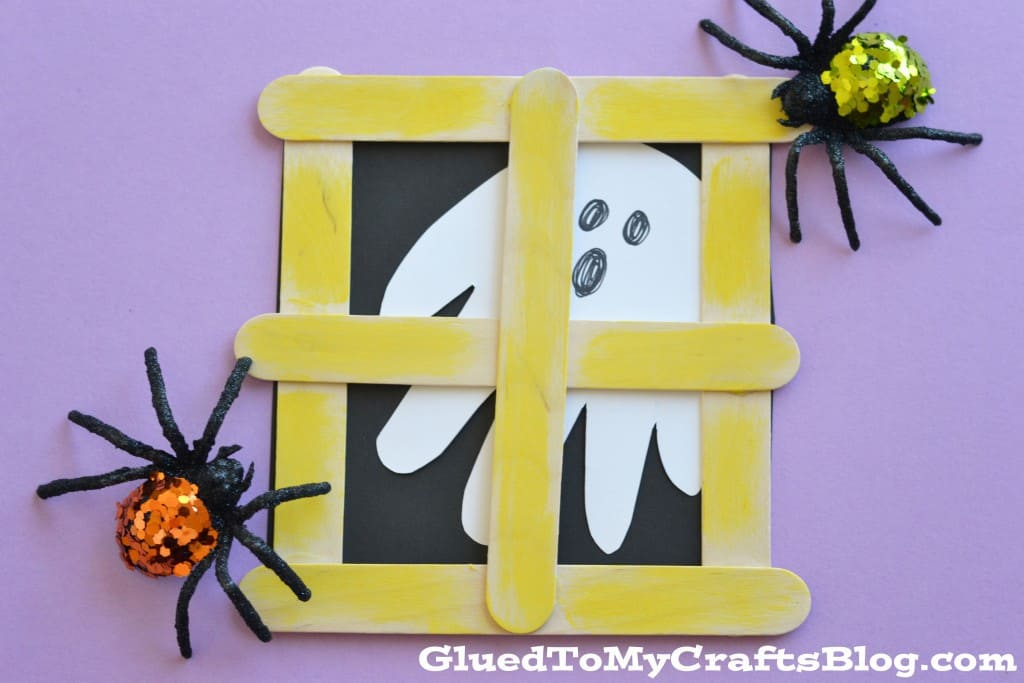 Popsicle stick craft meets handprint craft... what a fabulous idea! Love that little ghost peeking through the window.