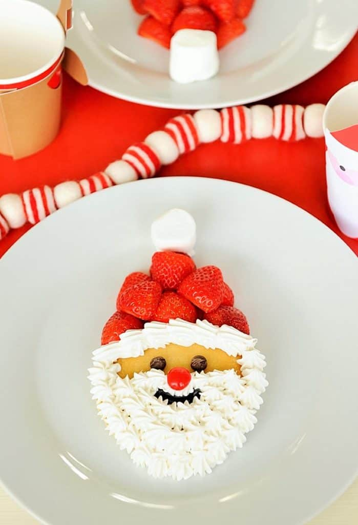 Ho Ho Ho! LOVE these Santa Claus pancakes - just make sure you let them cool a little before decorating or the cream will melt!