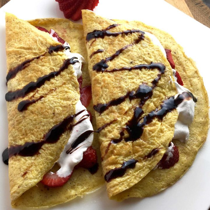 These gluten free flourless crepes are delicious wrapped around fresh strawberries and drizzled with a maple whipped cream!