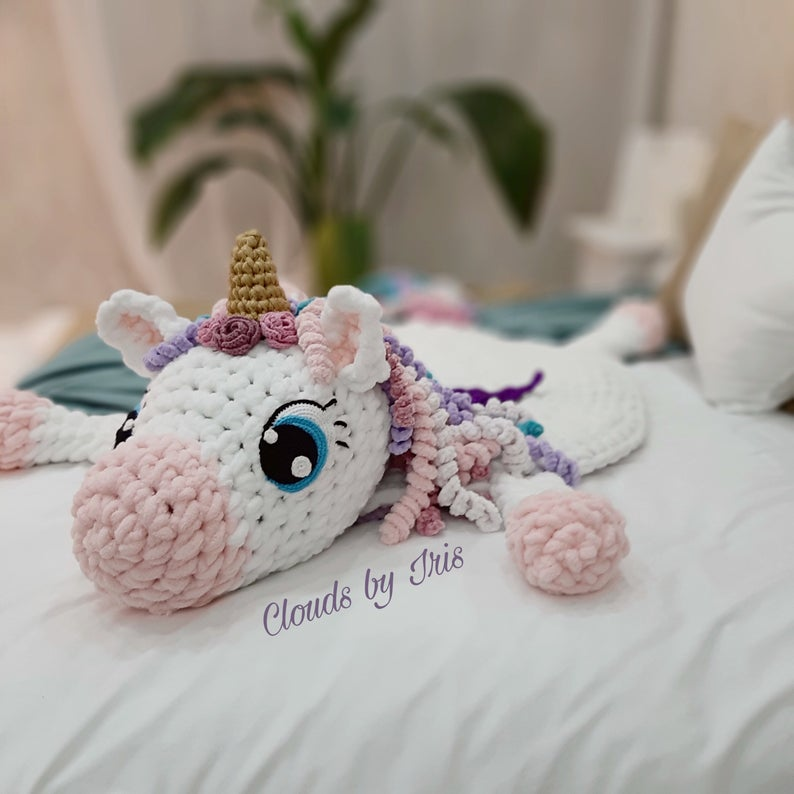 This magical looking unicorn is perfect for your nursery and is made by arm crocheting!