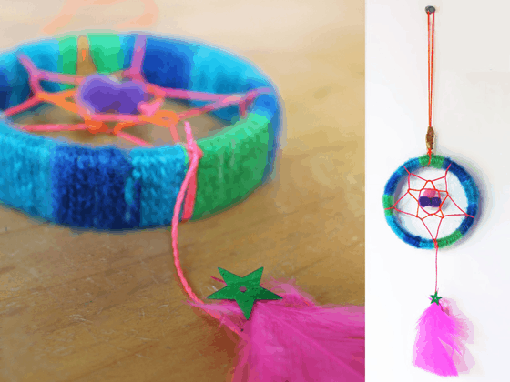 A picture of a mini dreamcatcher for children to make with a pink feather
