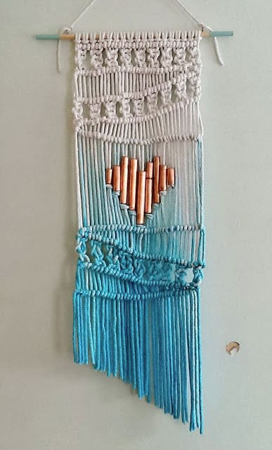 Make an ombre macrame wall hanging with a copper pipe heart.