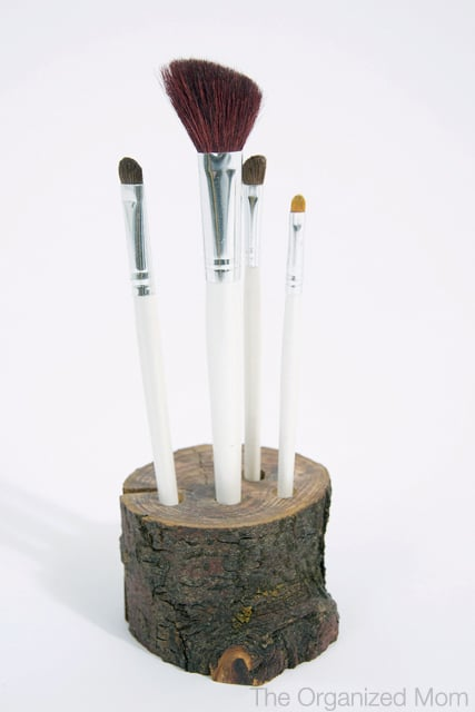 Next time your kids want to collect wood turn it into a makeup brush holder