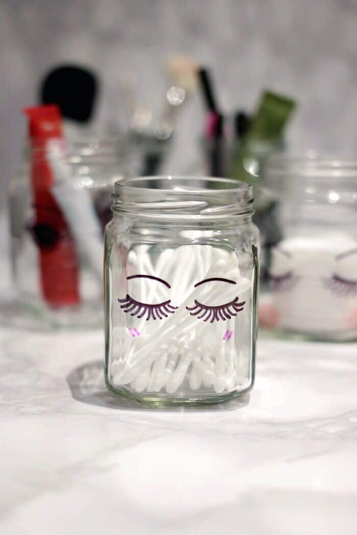 Glass jar plus Sharpie marker equals SUPER cute makeup storage