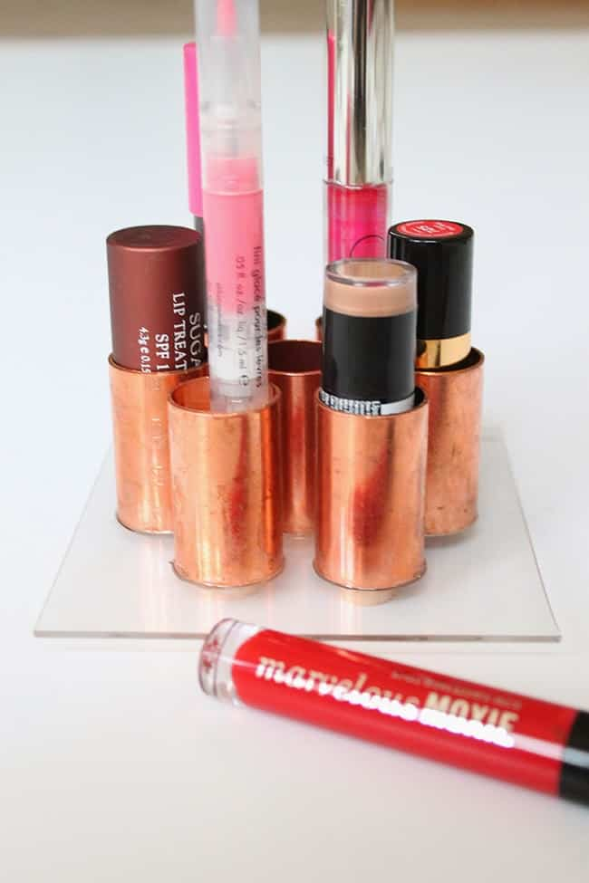 Store your lipsticks in this copper tube holder which is super simple to make