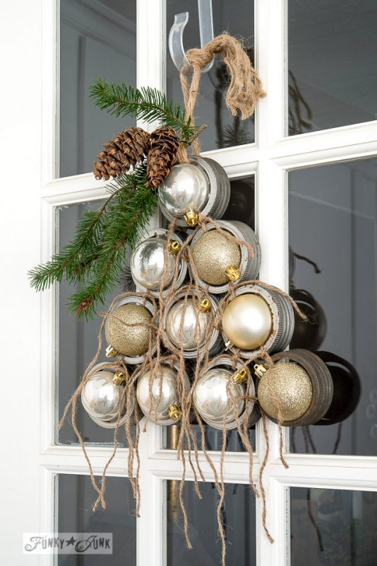 What a FABULOUS way to decorate your front door this Christmas. No one else will have a wreath made out of mason jar lids I bet!