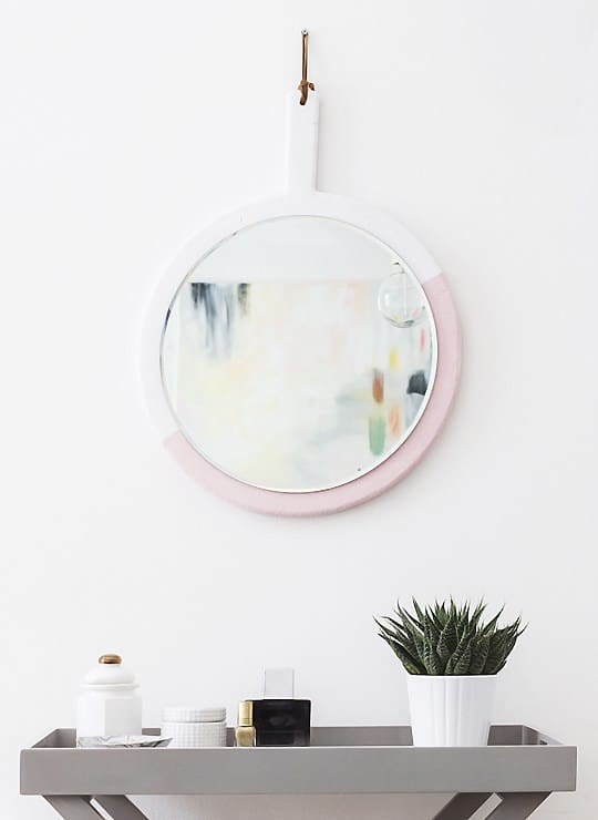 Use a chopping board to make a hanging mirror