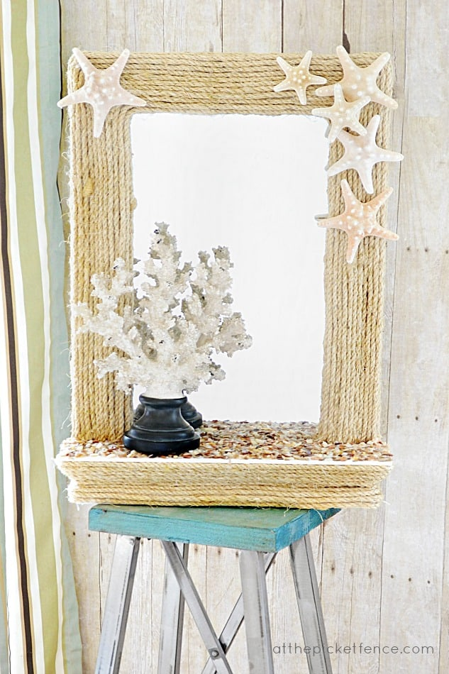 Use rope and starfish to make a nautical themed mirror