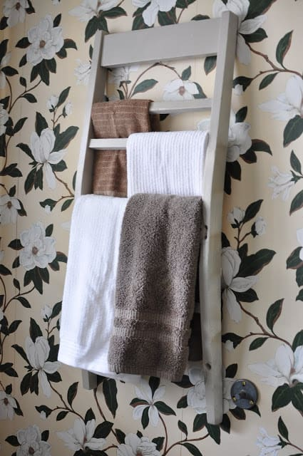 Turn an old chair back into a towel rack