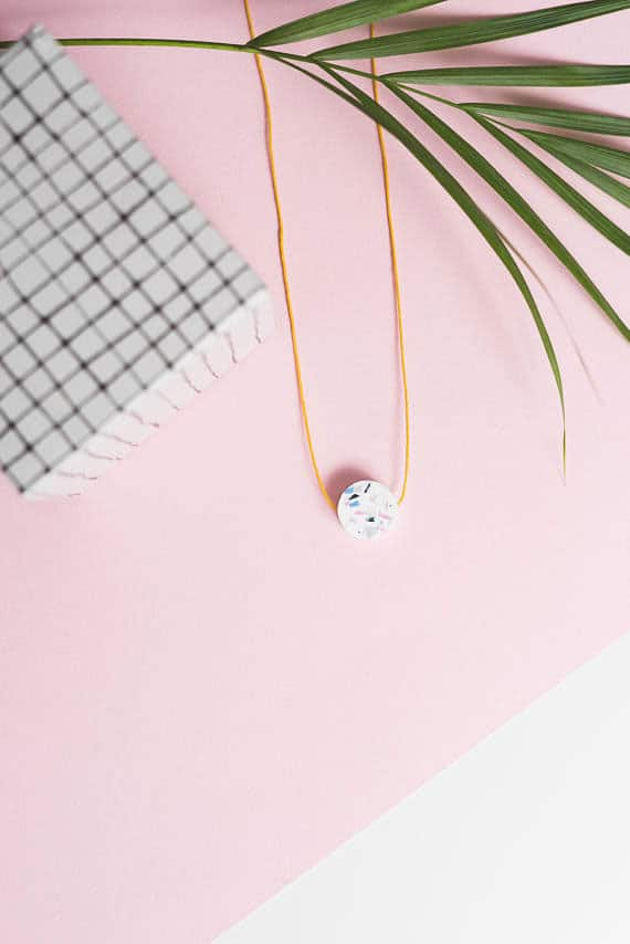 This minimalist pendant is the perfect addition to any outfit!