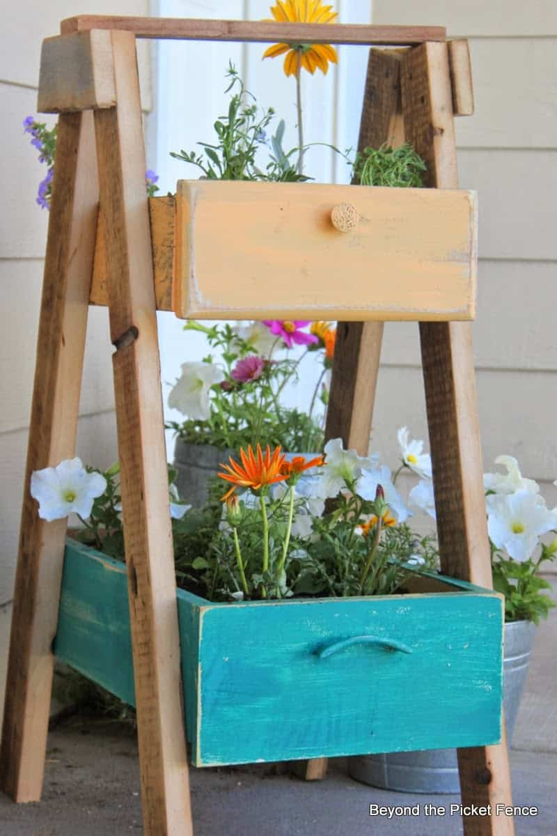 Brighten up your garden with a colourful planter made from old drawers